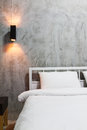 Loft bedroom white with gray cement wall Royalty Free Stock Photo