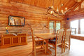 Log cabin dining room interior. Royalty Free Stock Photo