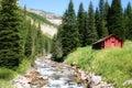 Log Cabin at Granite Creek Royalty Free Stock Photo