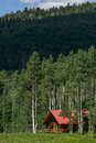 Log cabin home in mountain forest Royalty Free Stock Photo