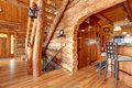 Log cabin kitchen and staircase interior. Stock Photography