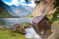 Log cabin on lake obersee lake germany landscape with at bavarian berchtesgaden Royalty Free Stock Photo