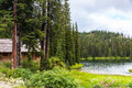 Log cabin in pine forest by lake at bridal kootenay rockies british columbia canada copy space Royalty Free Stock Photography