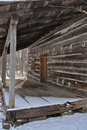 Log cabin porch in winter Stock Photos