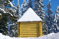 Log cabin in snowy forest Royalty Free Stock Photography