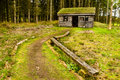 Log cabin in woods Stock Photography