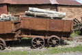 Log dram and and pit props rusty coal mine loaded with Stock Image