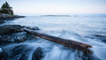 Log High and Dry on Rocks Royalty Free Stock Photo