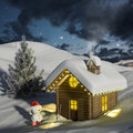 Log house in the snow at Christmas Stock Photo
