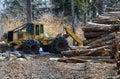 Log skidder and logs landing with Royalty Free Stock Image