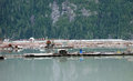 A logging scene at stewart floating buildings and logs as seen operation in british columbia canada Stock Photos