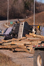Logging truck accident on highway with wood logs spilled Stock Photo