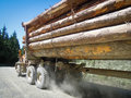 Logging truck carries a heavy load of trees cut down from the forest near port alberni on vancouver island in british columbia Royalty Free Stock Photography