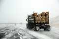 Logging truck on icy road Royalty Free Stock Photo