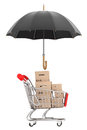 Logistics concept shopping cart with boxes being protected by a an umbrella on white background Royalty Free Stock Images