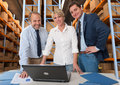 Logistics team b business with a storage warehouse at the background Royalty Free Stock Photos