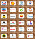 Logos of global oil and gas companies brands the largest private state owned on white tablet on rusted wooden background like Stock Images