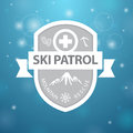 Logotype mountain ski patrol rescue on blue background Royalty Free Stock Photos