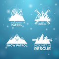 Logotype ski mounrain and snow patrol with mounrain rescue on blue background Stock Photos