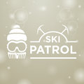 Logotype ski patrol on gray snow background with man Royalty Free Stock Photography