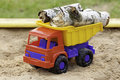 Logs in toy truck birch colorful Stock Image