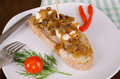 Loin tapa pork with goat cheese and caramelized onions spanish Royalty Free Stock Photo