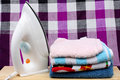 Loinclothpile of colorful clothes and electric iron on loincloth background Stock Image