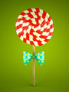 Lollipop with bow on green background d Royalty Free Stock Images