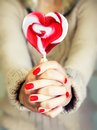Lollipop photo of girl holding heart shaped Royalty Free Stock Images