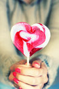 Lollipop photo of girl holding heart shaped Stock Photos