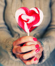 Lollipop photo of girl holding heart shaped Royalty Free Stock Photography