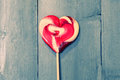 Lollipop photo of heart shaped on wooden background Royalty Free Stock Photography