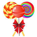 Lollipops background three with bow isolated on the white phone Royalty Free Stock Images