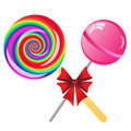 Lollipops background two with bow isolated on the white phone Stock Images