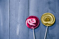Lollipops photo of pink and yellow on wooden background Stock Photos