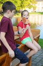 Lollipops siblings eating colorful big Royalty Free Stock Photos