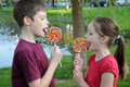 Lollipops siblings eating colorful big Stock Photography