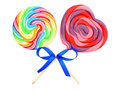 Lollipops two colorful with bow isolated on white Royalty Free Stock Photography