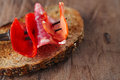 Lomo pork loin chorizo pamplona salchichon salame on meat for fork and bread Stock Photo