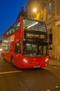 London bus at night red driving down street england Stock Photography