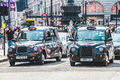 London cabs at piccadilly circus united kingdom july two black are waiting a traffic light Royalty Free Stock Photography