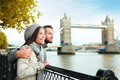 London couple by tower bridge river thames happy romantic young enjoying view during travel asian woman caucasian men in Stock Images