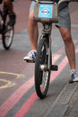 London cyclist londoner on a rented bicycle taking a little break on the road Royalty Free Stock Image