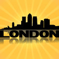 London docklands skyline reflected sunburst Royalty Free Stock Photo