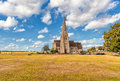 LONDON, ENGLAND - AUGUST 21, 2016: Blackheath with All Saints. Greenwich park with Cloudy Blue Sky and Green Grass. Royalty Free Stock Photo