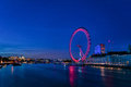 LONDON, ENGLAND - AUGUST 22, 2016: London Thames River and Spinning London Eye. Long Exposure Photo Shoot. Late Evening. Royalty Free Stock Photo