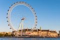 London eye in afternoon sun united kingdom may on may the giant ferris wheel is meters tall and the wheel has a Stock Image