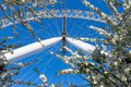 London Eye, ferris wheel, stands tall against deep blue spring s Royalty Free Stock Photo