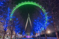 London eye in green and avenue of blue lit trees Stock Images