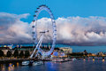 London Eye and Huge Cloud on London Cityscape Stock Photography